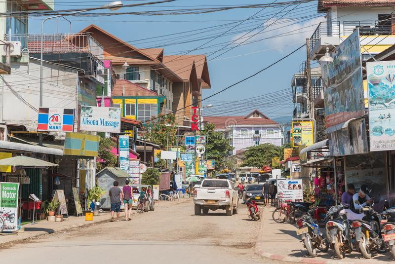 Vang Vieng`s chaotic architecture. Vang Vieng, Laos - December 28, 2018: one of the central streets of the city with its chaotic architecture and the abundance stock images