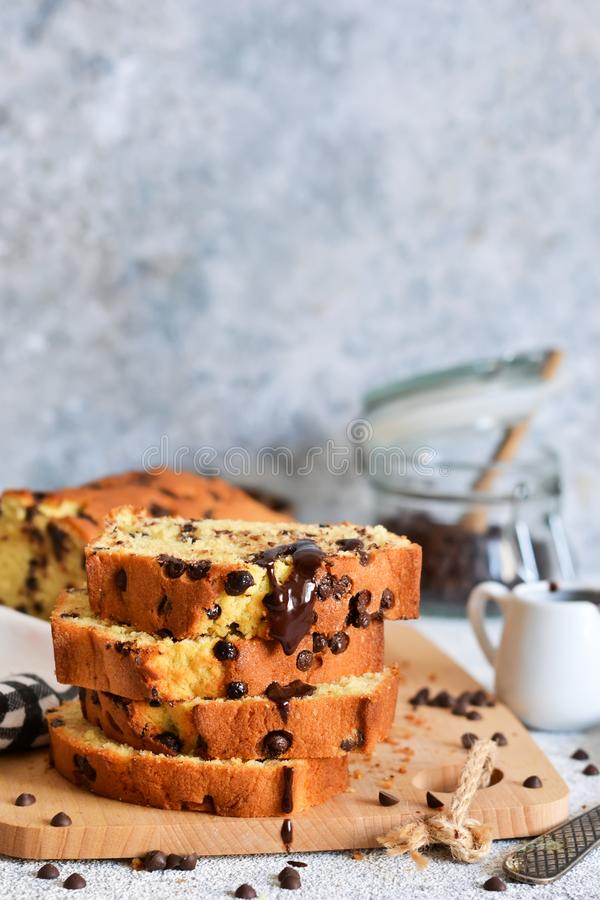Vanilla bread with chocolate drops on the kitchen table. Slices of cake royalty free stock photography