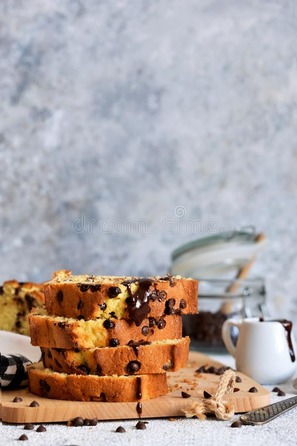 Vanilla bread with chocolate drops on the kitchen table. Slices of cake royalty free stock photo