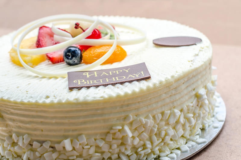 Vanilla Cake And Fruit With Words Happy Birthday Stock Photo - Words on cake for birthday