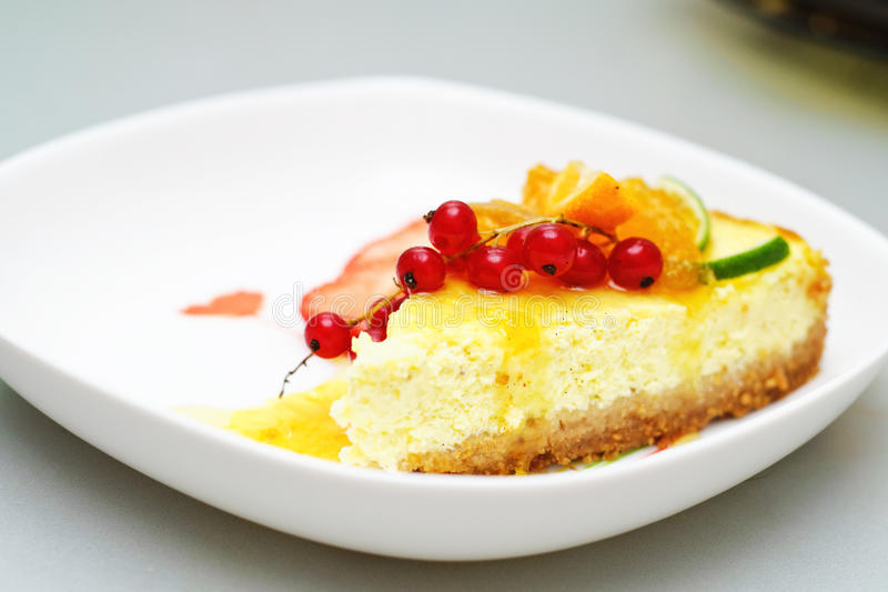Vanilla cheesecake. With fruits and jam stock photography