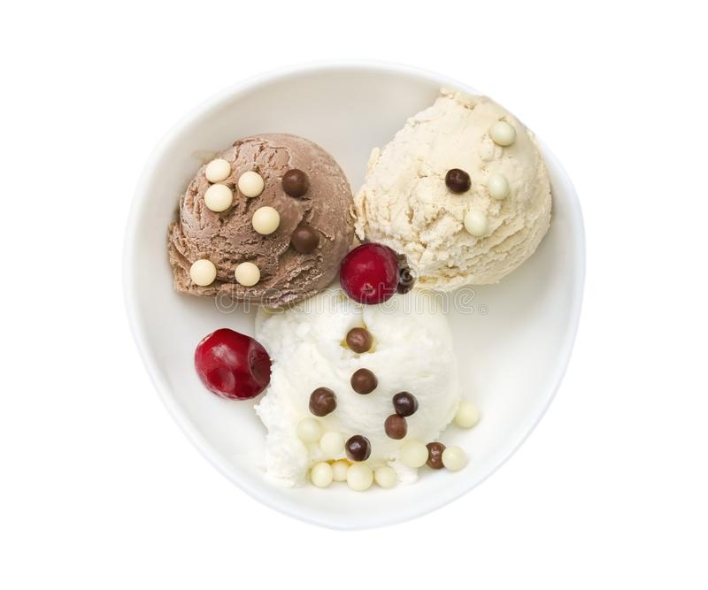 Vanilla and chocolate ice cream balls and chocolate crumbs with cranberry. Coffee creme brulee tasty ice cream with chocolate yogu royalty free stock photos