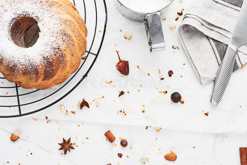 Vanilla and chocolate marble bundt cake with powdered sugar royalty free stock photo