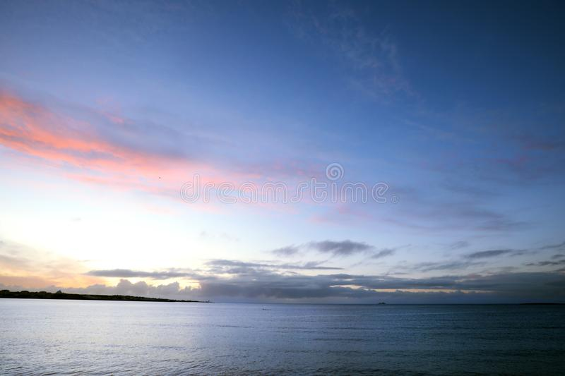 Vanilla clouds, sunset in Iceland. Vanilla clouds, sunset over the ocean in Iceland royalty free stock images