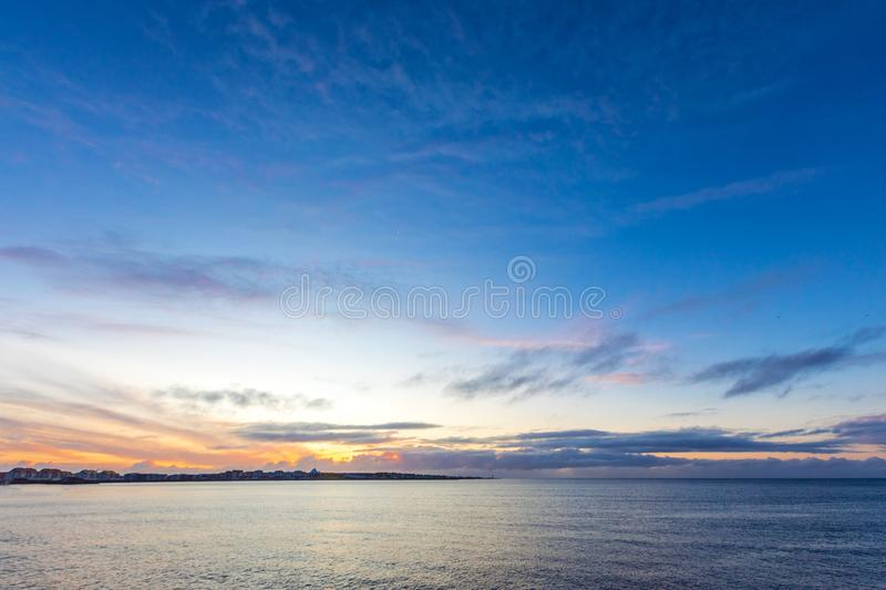 Vanilla clouds, sunset in Iceland. Vanilla clouds, sunset over the ocean in Iceland royalty free stock photos