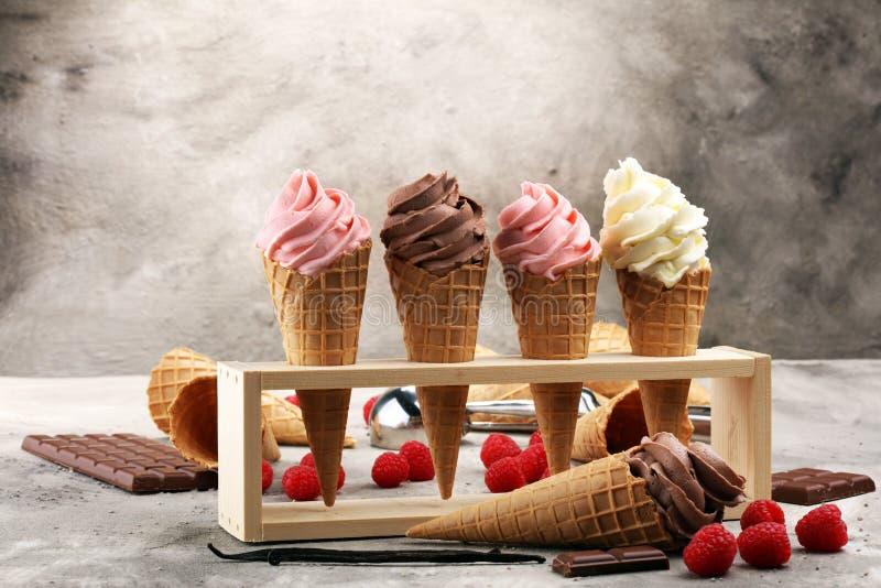 Vanilla frozen yogurt or soft ice cream in waffle cone. stock photos