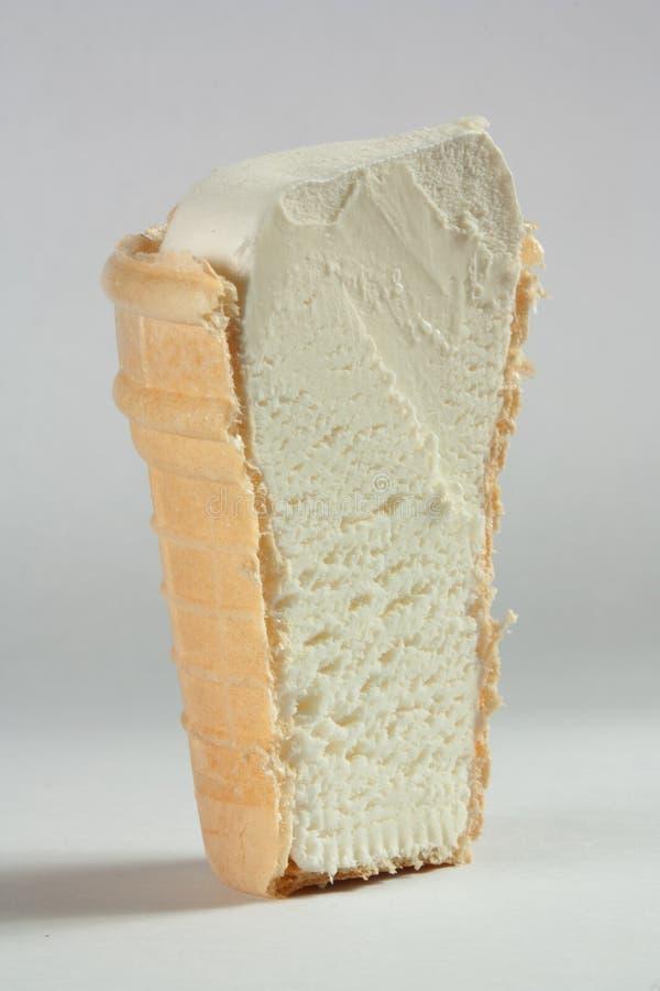Vanilla ice-cream. Cone cut in half stock photography