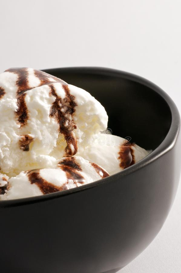 Vanilla ice cream in a black bowl stock photos