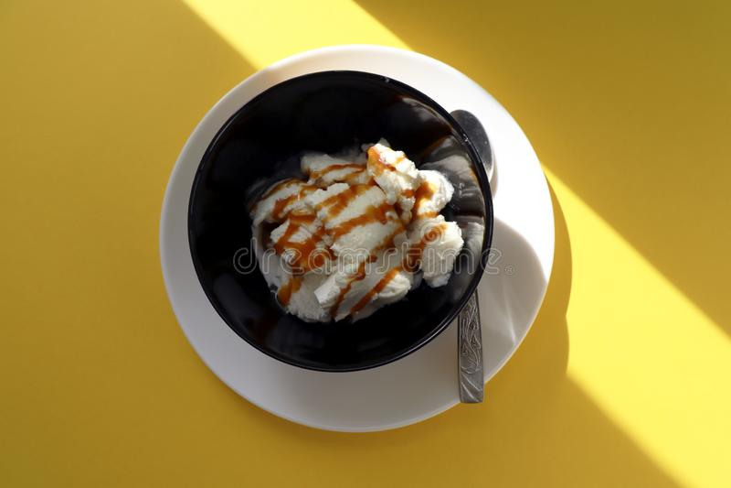 Vanilla ice cream in black bowl royalty free stock photos