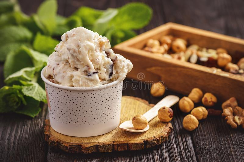Vanilla ice-cream with nuts and dried fruits. stock photos