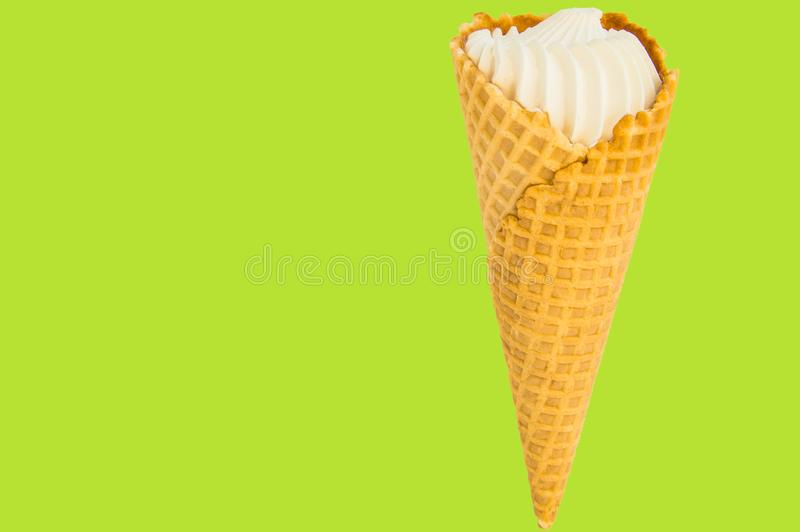 Vanilla ice cream on summer green-lemon background. Copy space, text space, layout.  royalty free stock image