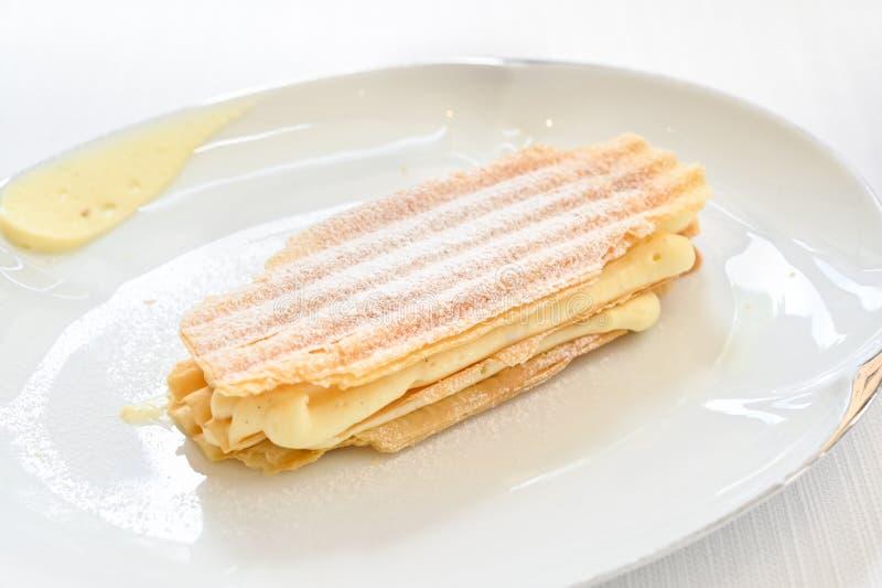 Vanilla mille feuille on white plate stock photos