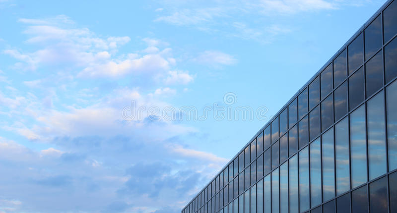 Vanilla sky. At the sunset and its reflection in the windows stock photos