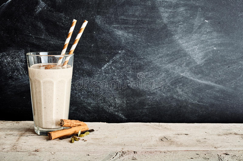 Vanilla smoothie in a tall glass with cinnamon royalty free stock photos