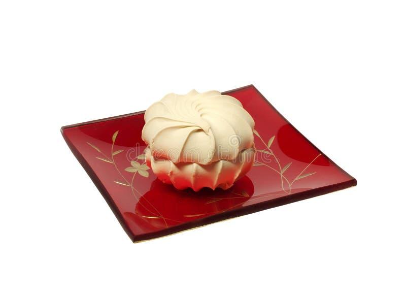 Vanilla sweet meringue kiss-cake on a square glass stock image
