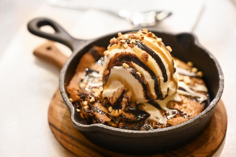 Vanilla ice cream with cookies in a pan royalty free stock photos