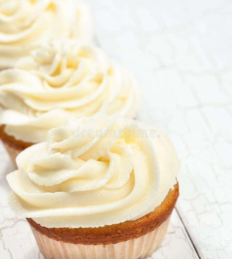 Vanille Cupcakes royalty-vrije stock afbeeldingen