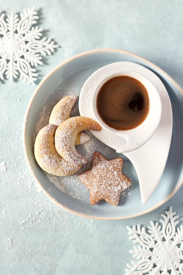 Vanillekipferl and cinnamon cookies. Christmas cookies and cup of coffee. Vanillekipferl and cinnamon cookies. Christmas cookies and cup of freshly brewed coffee royalty free stock photos