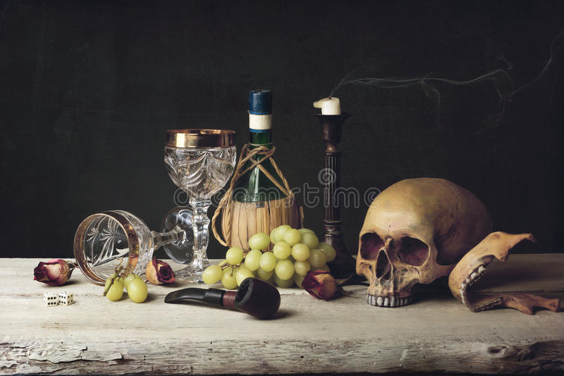 Vanitas with Skull; Pipe, tobacco, dice; wine glass, wine and g. Vanitas with Skull; Pipe, dice; wine glass, wine and grape stock image