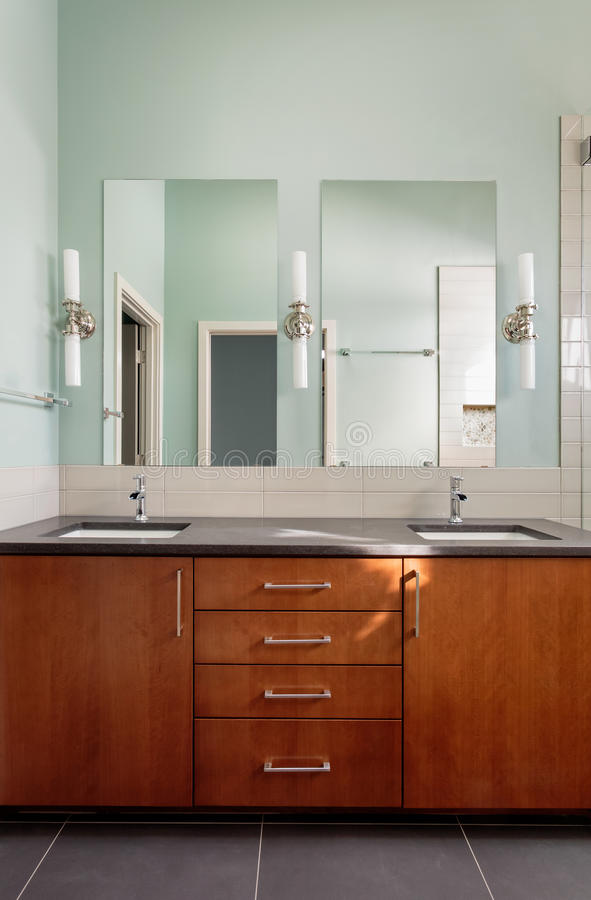 Vanity double sink and mirrors in modern bathroom royalty free stock photo
