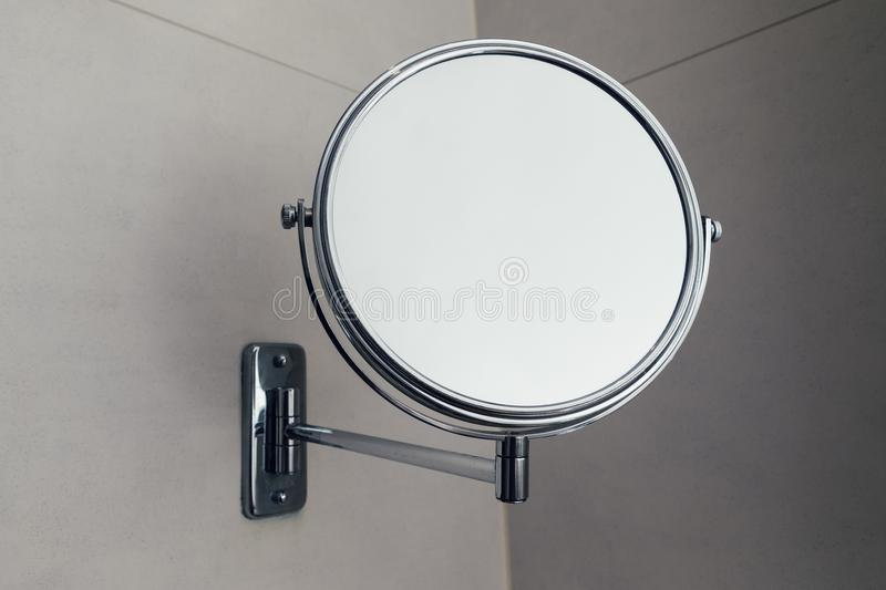 Vanity round mirror in bathroom, closeup view royalty free stock images