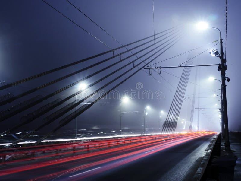 Vansu Bridge lights in fog ,Riga stock image