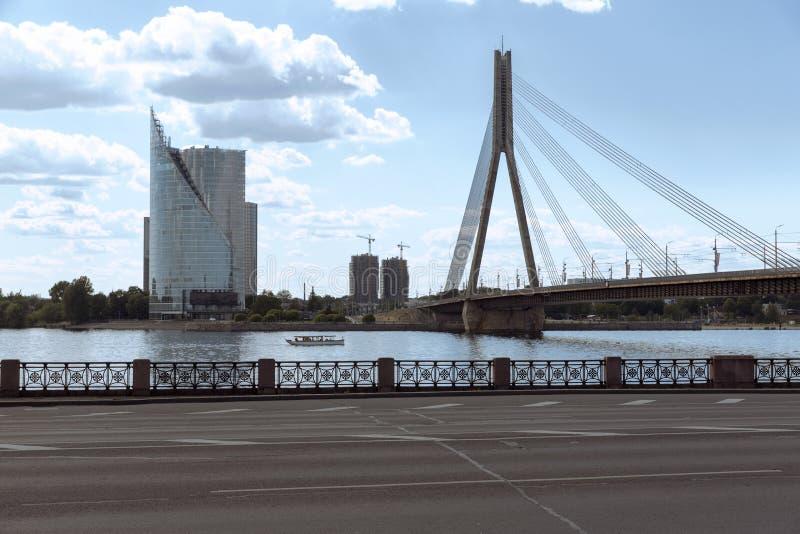 Vansu bridge over river Daugava Riga, Latvia. City view of bridge, office building and street royalty free stock photography