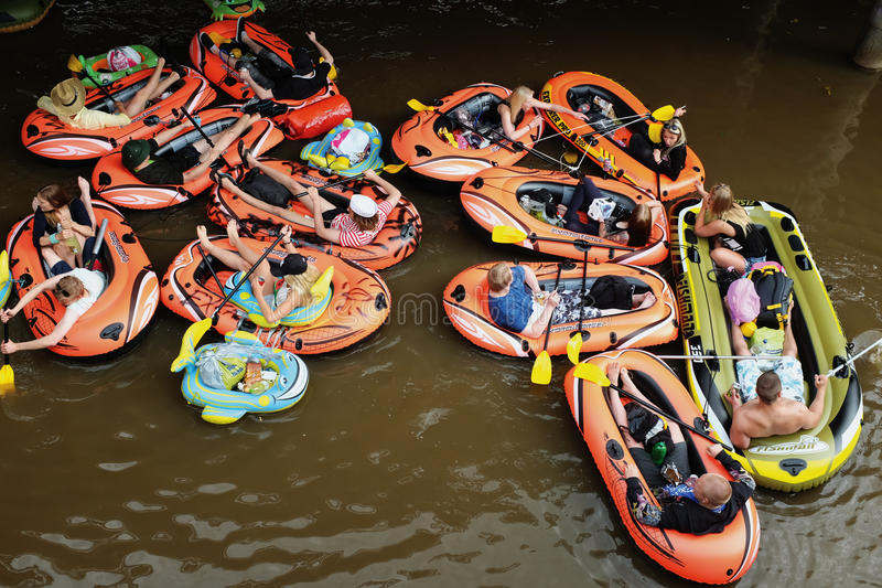 VANTAA, FINLAND – AUGUST 1, 2015: Beer Floating (kaljakellunta. ), summer event, where the participants float down the Vantaa River using small rubber royalty free stock images