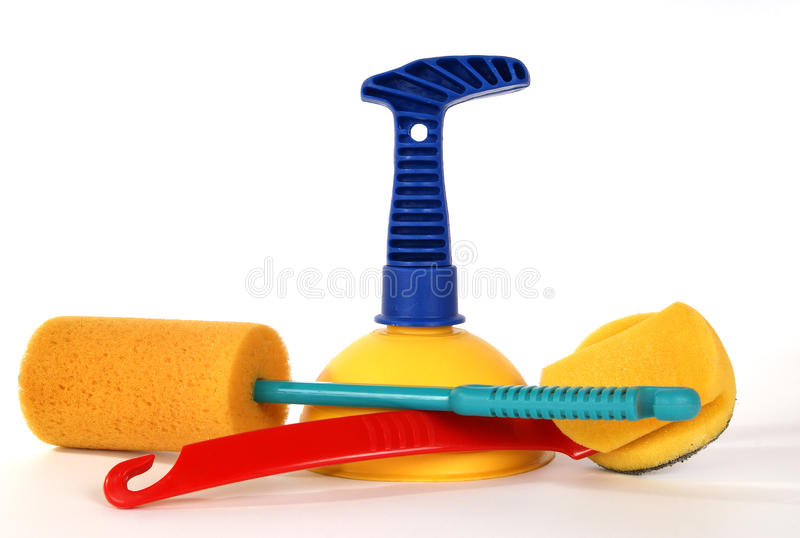 Vantuz (plunger) and brushes to clean the toilet. Room, on a white background royalty free stock photo