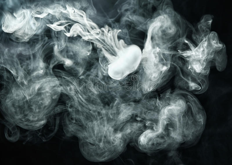 Vape ring like smoke ring on dark background royalty free stock photography