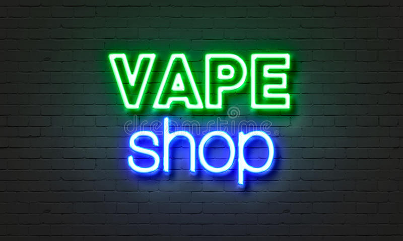 Vape shop neon sign on brick wall background. royalty free stock images
