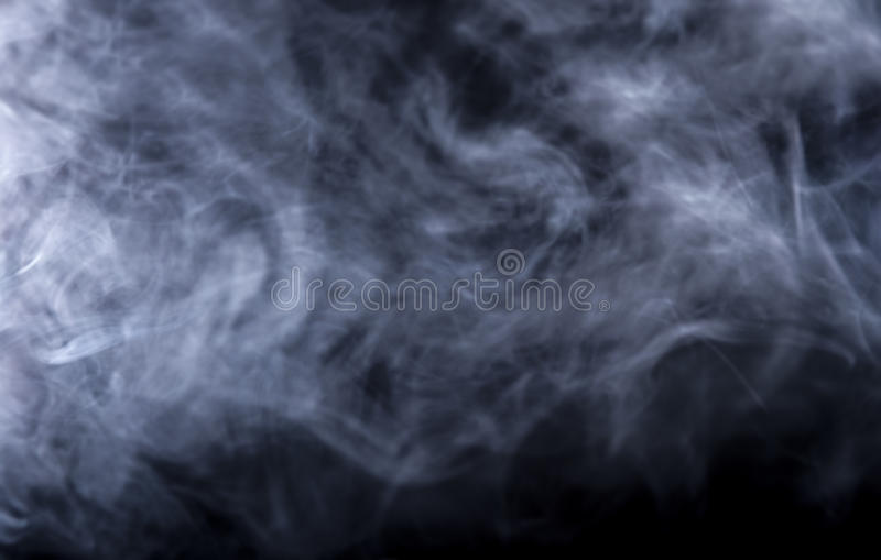 Vape Smoke on Black Background. Smoke from a Vape with light effects on a black background. The image is an abstract texture with copy or text space. It has stock images