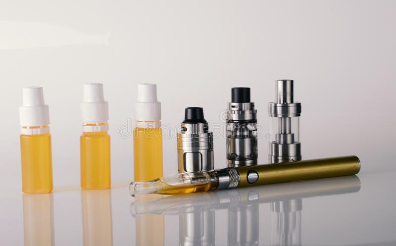 vape tanks and e liquid for electronic cigarette or e c royalty free stock images