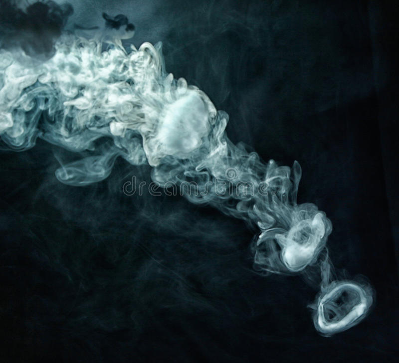 Vape trick smoke ring on dark background stock photo