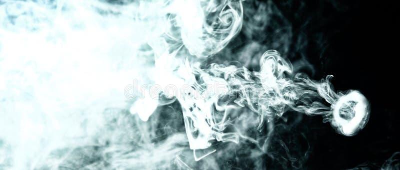 Vape trick smoke ring on dark background stock image
