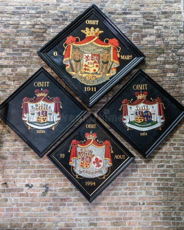 Vapensköld för fyra familj på den Jerusalem kyrkan, Bruges Belgien royaltyfria bilder