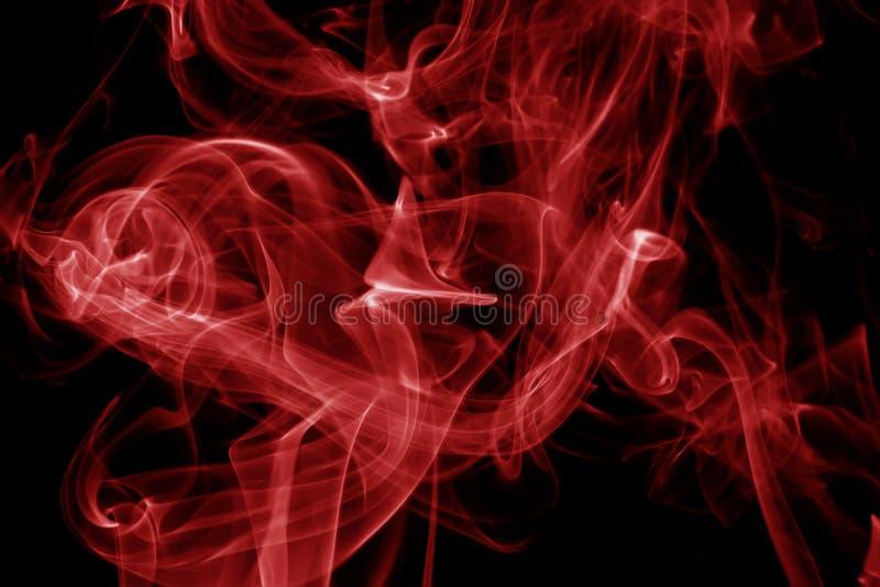 Vapeur rouge sur le fond noir images stock