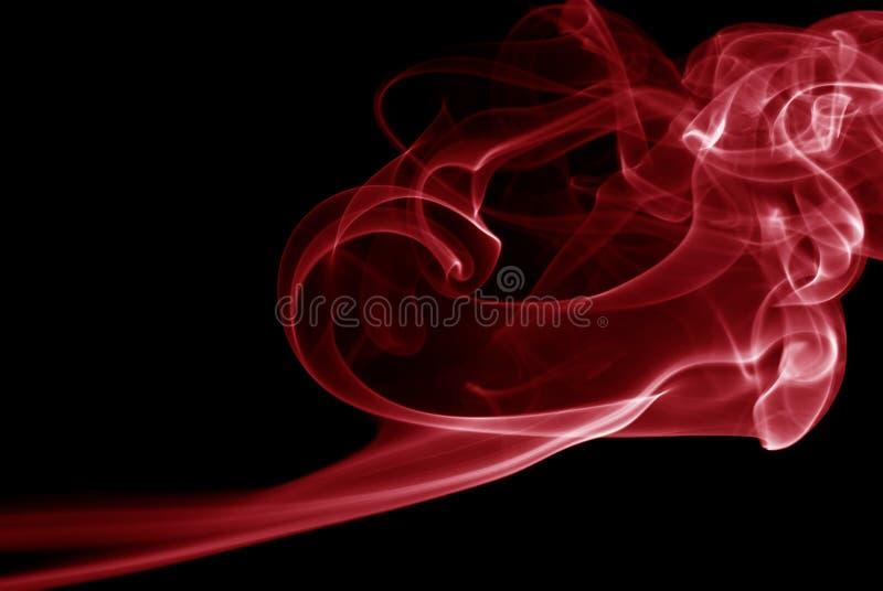 Vapeur rouge sur le fond noir photos libres de droits