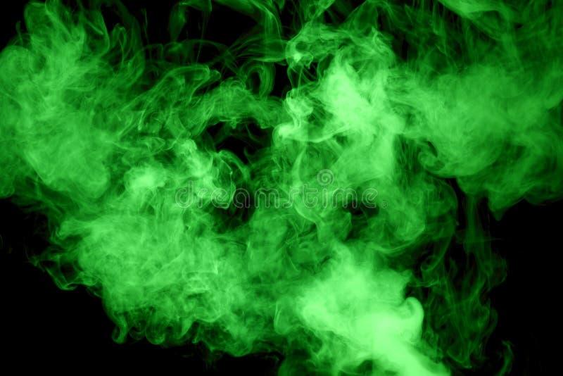 Vapeur verte sur le fond noir image libre de droits