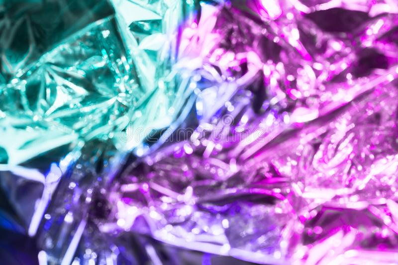 Vaporwave style holographic texture background: neon pink funky paint texture. Close up, flat lay royalty free stock photos