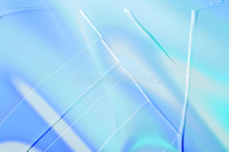 Vaporwave style texture background: neon blue funky paint texture. Vaporwave style texture background: neon blue holographic funky paint wave texture. Close up royalty free stock images