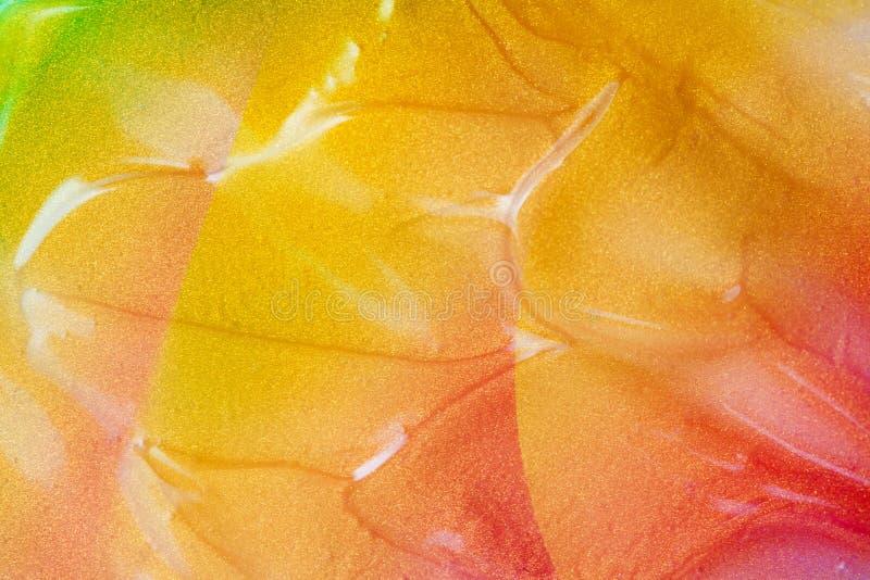 Vaporwave style texture background: neon orange funky paint texture. Vaporwave style texture background: neon orange funky paint wave texture. Close up, flat lay royalty free stock images