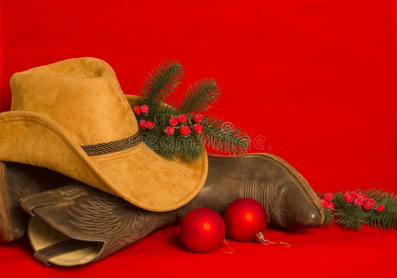Vaqueiro Christmas Botas e chapéu tradicionais ocidentais americanos no chri fotos de stock