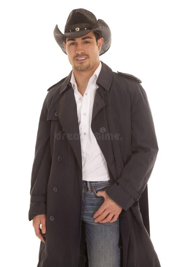 Vaqueiro na mão do revestimento no bolso fotografia de stock royalty free