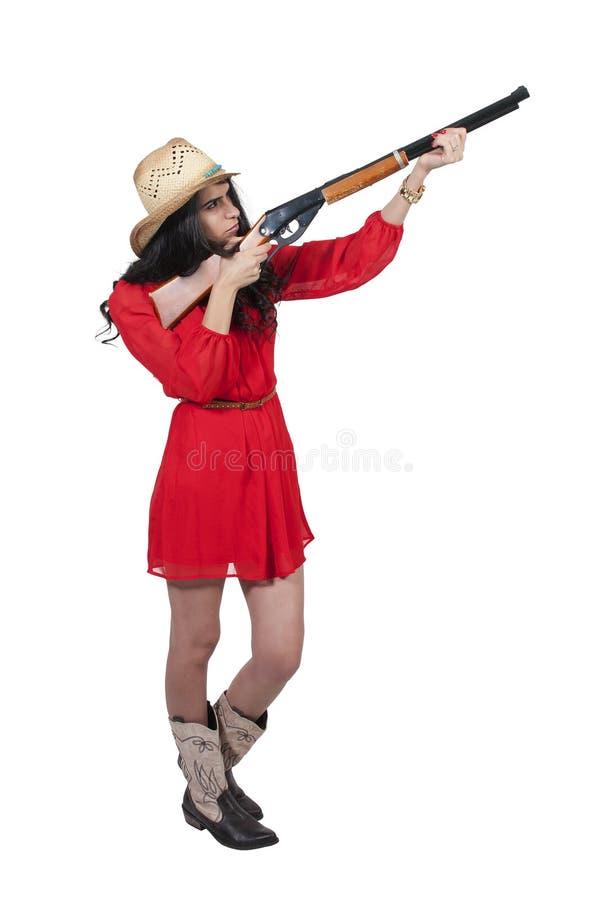 Vaquera con el rifle imagenes de archivo