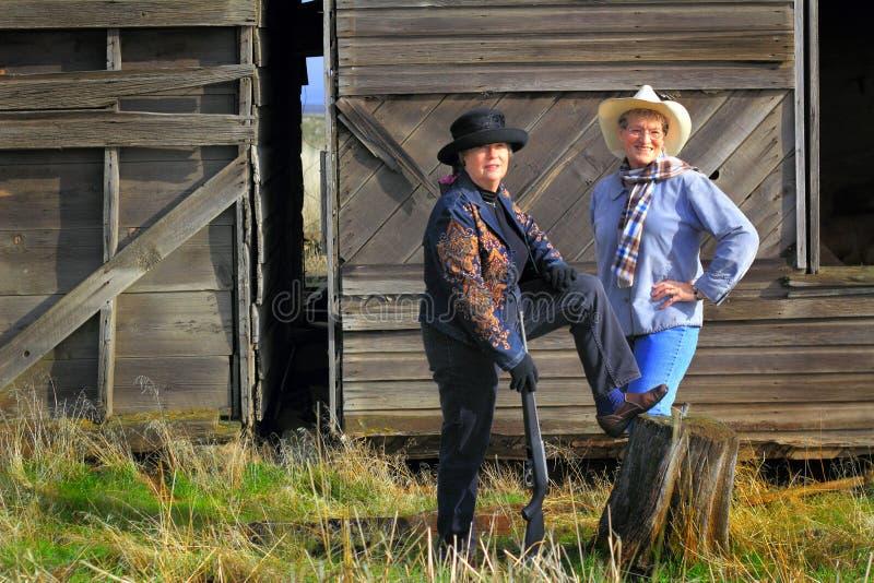Vaqueras del Gunslinger del país imágenes de archivo libres de regalías