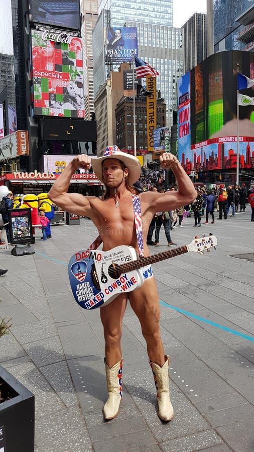 Vaquero desnudo en Times Square, New York City foto de archivo