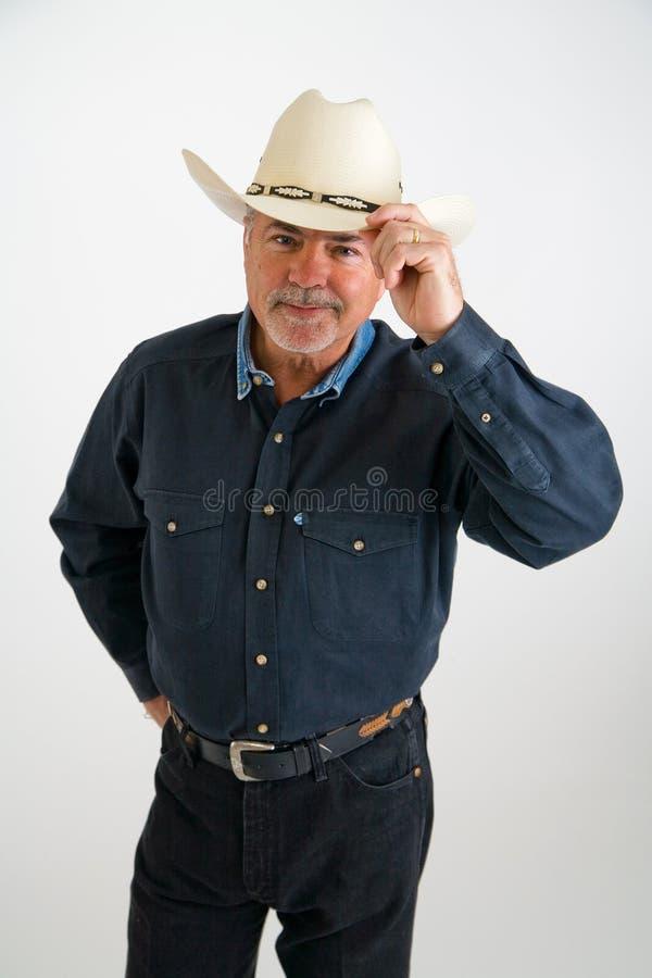 Vaquero que inclina el sombrero imagen de archivo libre de regalías