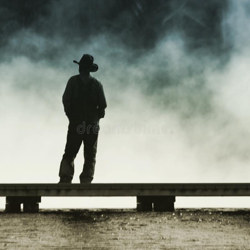 Vaquero Silhouette de Yellowstone foto de archivo