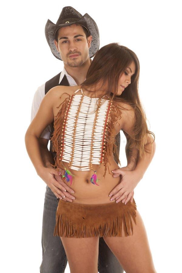 Vaquero y mujer india que ella en manos delanteras hincha fotos de archivo